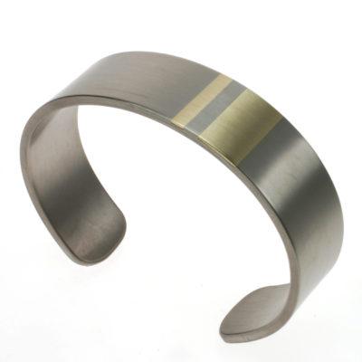 Brede armband titanium met goud