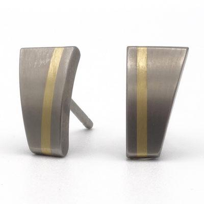 titanium oorbellen met goud